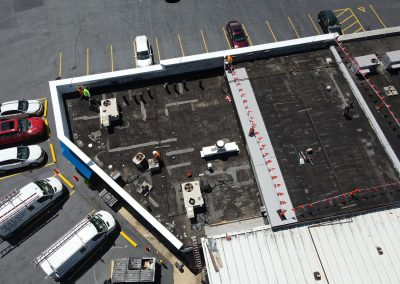 Workers Repairing a Commercial Roof
