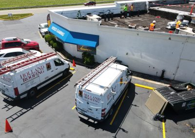 Holland Roofing vans on a repair job
