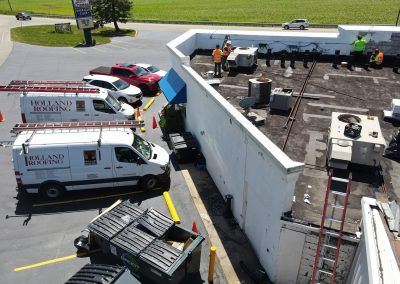 Roofing crew repairing commercial roof