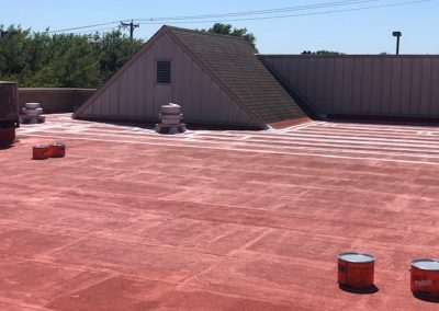 Red flat roof getting sealed