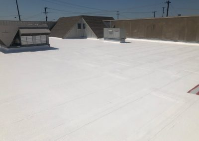 White roof coating on commercial roof