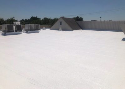 Commercial roof with white roof coating